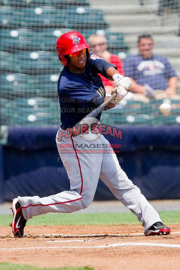 Josh Johnson #15 of the Harrisburg Senators takes his swings against the Richmond Flying Squirrels at The Diamond on July 22, 2011 in Richmond, Virginia.  The Squirrels defeated the Senators 5-1.   (Brian Westerholt / Four Seam Images)