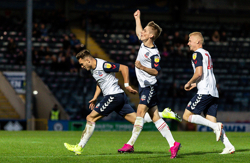 Bolton Wanderers' Dennis Politic (left) celebrates scoring his side's second goal with his team mates Ronan Darcy (centre) and James Weir (right) <br /> <br /> Photographer Andrew Kearns/CameraSport<br /> <br /> The Carabao Cup First Round - Rochdale v Bolton Wanderers - Tuesday 13th August 2019 - Spotland Stadium - Rochdale<br />  <br /> World Copyright © 2019 CameraSport. All rights reserved. 43 Linden Ave. Countesthorpe. Leicester. England. LE8 5PG - Tel: +44 (0) 116 277 4147 - admin@camerasport.com - www.camerasport.com