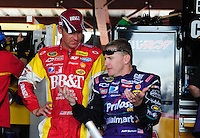 May 1, 2009; Richmond, VA, USA; NASCAR Sprint Cup Series driver Clint Bowyer (left) with teammate Jeff Burton during practice for the Russ Friedman 400 at the Richmond International Raceway. Mandatory Credit: Mark J. Rebilas-