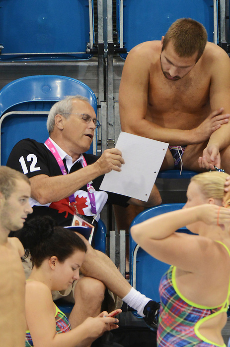 LONDON, ENGLAND – 08/24/2012: Reg Chappel goes over notes with Nathan Stein a training session at the London 2012 Paralympic Games at The Aquatic Centre. (Photo by Matthew Murnaghan/Canadian Paralympic Committee)