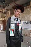 Israel, Jerusalem. Purim holiday at the Ultra Orthodox Me?a She?arim quarter, the Hassid is displaying his Palestinian scarf and ?A Jew not a Zionist? stickers, 2005<br />