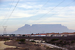The view of Table mountain, from a brothel which was located in Hume Road, in the Table View residential area in Cape Town. The Vice Squad closed the brothel down after a raid on Saturday 24th April, where they found four Asian girls illegally working as escorts, including a young Chinese girl who was suspected to be trafficked (age unknown), as she was found without any papers and was deported immediately by home affairs. The Vice Squad has so far listed 49 illegal brothels that they officially know of in Table View. This brothel in Hume road was only 100 yards away from a thriving Gospel Church and children's playground.