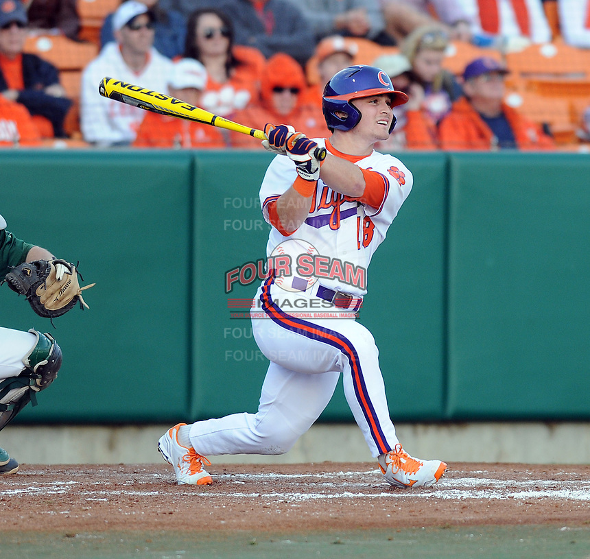 Left fielder Tyler Slaton (18) of the Clemson Tigers in a game against the William & Mary Tribe on Opening Day, Friday, February 15, 2013, at Doug Kingsmore Stadium in Clemson, South Carolina. Clemson won, 2-0. (Tom Priddy/Four Seam Images)