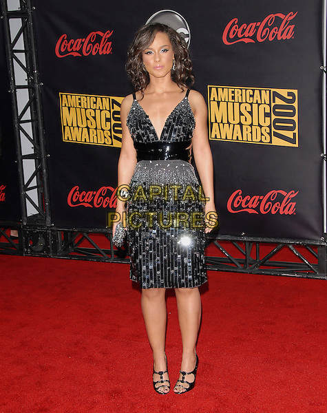 ALICIA KEYS.At The 35th Annual American Music Awards held at The Nokia Theatre in Los Angeles, California, USA, .November 18, 2006..full length black sequined dress.CAP/DVS.©Debbie VanStory/Capital Pictures