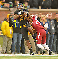 NWA Media/Michael Woods --11/28/2014-- w @NWAMICHAELW...Missouri receiver Bud Sasser goes up to make a catch as he is hit by Arkansas defender Jared Collins (29) the 3rd quarter of Friday afternoons game against Missouri at Faurot Field in Columbia Missouri.