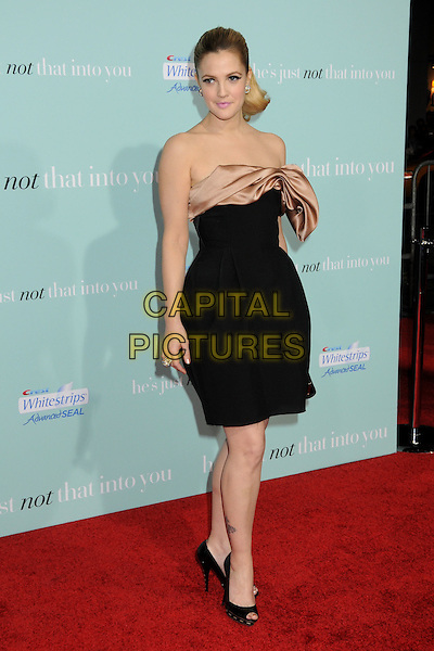 """DREW BARRYMORE.""""He's Just Not That Into You"""" Los Angeles Premiere at Grauman's Chinese Theatre, Hollywood, CA, USA, .02 February 2009.full length black strapless dress bow beige silk satin open toe shoes .CAP/ADM/BP.©Byron Purvis/Admedia/Capital PIctures"""