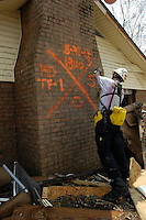 Search and rescue workers are seen in Waveland Ms. following Hurricane Katrina, Aug. 31,2005. .Photo©Suzi Altman