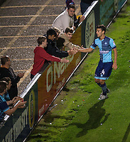 Scott Kashket of Wycombe Wanderers celebrates his goal with supporters during the The Checkatrade Trophy match between Wycombe Wanderers and West Ham United U21 at Adams Park, High Wycombe, England on 4 October 2016. Photo by Andy Rowland.