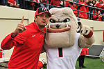NASHVILLE, TN - OCTOBER 19:  Country singer Luke Bryan poses for a photo with University of Georgia mascot Hairy during a game between the Georgia Bulldogs and the Vanderbilt Commodores at Vanderbilt Stadium on October 19, 2013 in Nashville, Tennessee.  (Photo by Frederick Breedon/Getty Images)