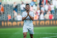 Neil Taylor of Swansea  applauds fans after the Barclays Premier League match between Swansea City and Everton played at the Liberty Stadium, Swansea  on September 19th 2015