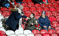 A family of Brentford FC fans seen during the Sky Bet Championship match between Brentford and Leeds United at Griffin Park, London, England on 4 November 2017. Photo by Carlton Myrie.
