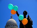 Forward statue holding balloons at the Wisconsin State Capitol.