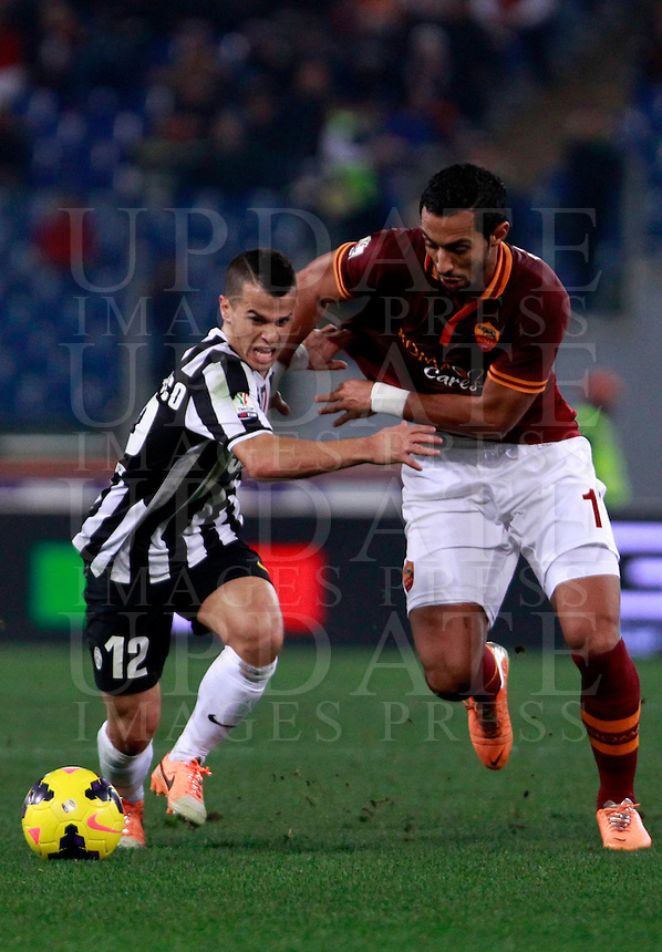 Calcio, quarti di finale di Coppa Italia: Roma vs Juventus. Roma, stadio Olimpico, 21 gennaio 2014.<br /> Juventus forward Sebastian Giovinco, left, and AS Roma defender Mehdi Benatia, of Morocco, fight for the ball during the Italian Cup round of eight final football match between AS Roma and Juventus, at Rome's Olympic stadium, 21 January 2014.<br /> UPDATE IMAGES PRESS/Isabella Bonotto
