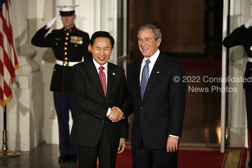 Washington, DC - November 14, 2008 -- United States President George W. Bush greets  Lee Myung-bak, President of South Korea to the White House for a working dinner at the start of the G20 Summit on Financial Markets and the World Economy..Credit: Gary Fabiano - Pool via CNP