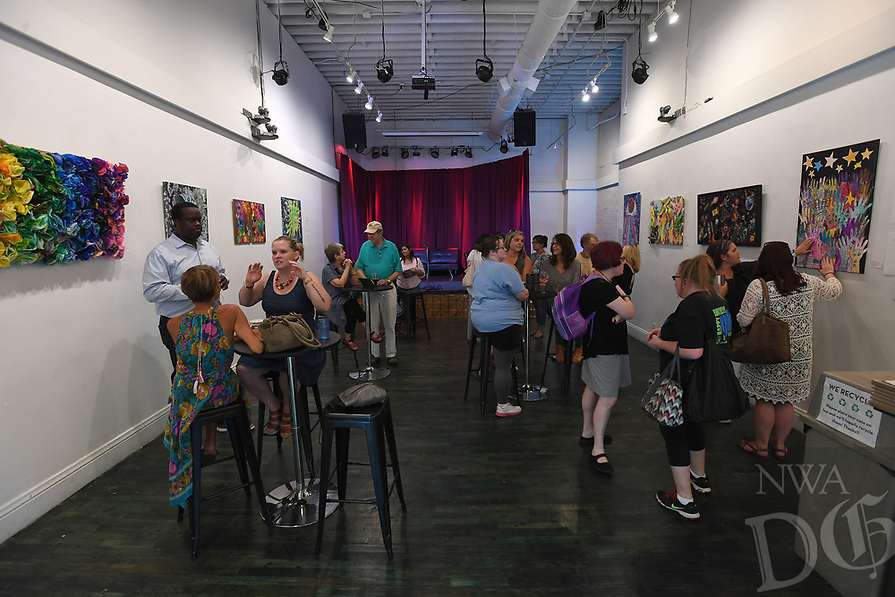 NWA Democrat-Gazette/J.T. WAMPLER Artists and guests mingle Thursday Aug. 2, 2018 during a reception for the artists of Life Styles latest exhibition, ÒConspire to InspireÓ at Stage 18 in Fayetteville. Life Style artists worked in groups towards the goal of uniting their personal styles to create something greater together. Life Styles Inc. supports individuals with disabilities in reaching their full potential as contributing members of the community.