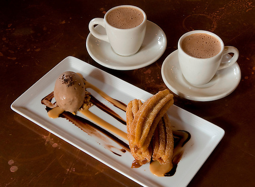Churros rellenos stuffed with dulce de leche and served with chocolate home made ice cream and mexican hot chocolate is a featured dish at Hugo's restaurant at 1600 Westheimer.  (Tuesday, Feb. 24, 2009, in Houston. ( Steve Campbell / Houston Chronicle)