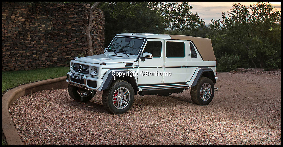 BNPS.co.uk (01202 558833)Pic: Bonhams/BNPS<br /> <br /> Mercedes' 'G-class' Maybach G650.<br /> <br /> AA limited edition Mercedes G-class has sold for a massive £1.2m at auction - a world record for the footballers favourite.<br /> <br /> The Mercedes-Maybach G650 Landaulet, is one of 99 to be made and sold for more than double the list price of €630,000 (Around 563,000).<br /> <br /> The height of luxury, features include heated cup holders, massage chairs, individual fully-reclinable seats and a partition between driver and passengers which goes from clear to opaque in seconds.<br /> <br /> It also has a canvas roof which opens at the touch of a button, fold-out leather tables, silver champagne flutes and state of the art entertainment systems.
