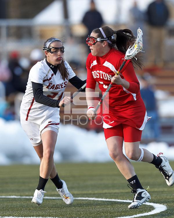 Boston University attacker Elizabeth Morse (5) on the attack as Boston College midfielder Caroline Margolis (21) defends..Boston College (white) defeated Boston University (red), 12-9, on the Newton Campus Lacrosse Field at Boston College, on March 20, 2013.