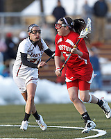 Boston University attacker Elizabeth Morse (5) on the attack as Boston College midfielder Caroline Margolis (21) defends..Boston College (white) defeated Boston University (red), 12-9, on the Newton Campus Lacrosse Field at Boston College, on March 20, 2013.