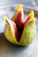 Detail of a fresh fig cut into a petal shape to resemble a flower