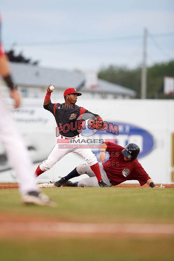 Batavia Muckdogs second baseman Samuel Castro (5) throws to first base as Dillon Persinger  (50) slides in during a game against the Mahoning Valley Scrappers on August 18, 2017 at Dwyer Stadium in Batavia, New York.  Mahoning Valley defeated Batavia 8-2.  (Mike Janes/Four Seam Images)