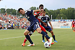 09 July 2014: Dallas' Fabian Castillo (COL) (in red) is defended by Carolina's Kupono Low (3) and Cesar Elizondo (CRC) (behind). The Carolina RailHawks of the North American Soccer League played FC Dallas of Major League Soccer at WakeMed Stadium in Cary, North Carolina in the quarterfinals of the 2014 Lamar Hunt U.S. Open Cup soccer tournament. FC Dallas won the game 5-2.