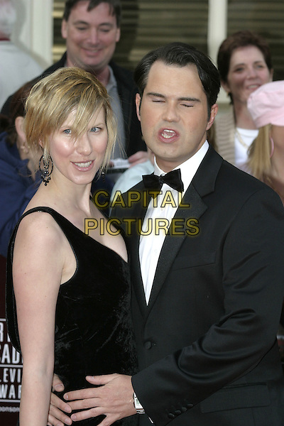 JIMMY CARR & GUEST.Arrivals at the Pioneer British Academy Television Awards (TV BAFTA's), Theatre Royal, Drury Lane, .London, April 17th 2005..half length eyes shut closed blinking funny face lips.Ref: AH.www.capitalpictures.com.sales@capitalpictures.com.©Adam Houghton/Capital Pictures.