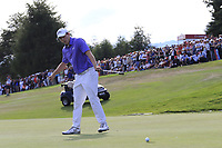 Matthew Fitzpatrick (ENG) sinks his birdie putt on the playoff green 18 at the end of Sunday's Final Round to win the 2018 Omega European Masters, held at the Golf Club Crans-Sur-Sierre, Crans Montana, Switzerland. 9th September 2018.<br /> Picture: Eoin Clarke | Golffile<br /> <br /> <br /> All photos usage must carry mandatory copyright credit (&copy; Golffile | Eoin Clarke)
