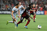1st January 2020; Bankwest Stadium, Parramatta, New South Wales, Australia; Australian A League football, Western Sydney Wanderers versus Brisbane Roar; Mohamed Adam of Western Sydney Wanderers gets past Jack Hingert of Brisbane Roar - Editorial Use