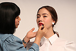 """September 21, 2016, Tokyo, Japan - Japan's cosmetics giant Shiseido chief professional make-up artist Miyako Okamoto (L) gives a make-up to a model as the company will launch the new make-up brand """"Playlist"""" in Tokyo on Wednesday, September 21, 2016. Playlist is developed by Shiseido's professional make-up artists and users will be able to have web counselling and make-up tips through the Internet.   (Photo by Yoshio Tsunoda/AFLO) LWX -ytd-"""