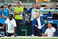 Brazil head coach Luiz Felipe Scolari looks dejected with Thiago Silva standing by the side