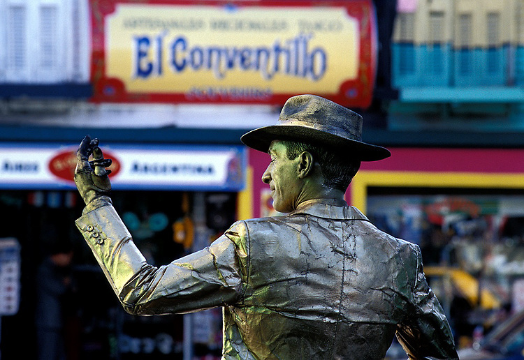 "Tango and Gardel were before Maradona the icons of the city with projection to the world.  While many lack the voice and charm of  ""el zorzal"" (Carlos Gardel) they may try to resemble the look of the great singer by standing still and gathering a few coins."