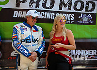 Jun 17, 2018; Bristol, TN, USA; NHRA funny car driver John Force (left) with daughter Courtney Force during the Thunder Valley Nationals at Bristol Dragway. Mandatory Credit: Mark J. Rebilas-USA TODAY Sports