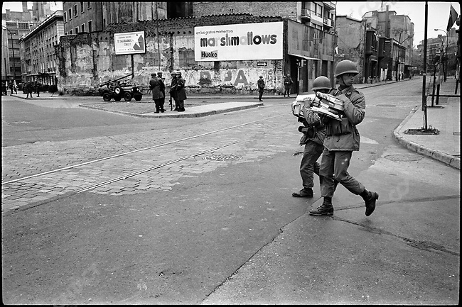 """In the aftermath of the military Coup D'Etat, soldiers carry away """"subversive books"""" to be burnt. Santiago, Chile, September 26, 1973"""