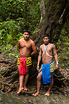 Two indigenous Embera men in traditional dress in the rainforest in Panama. Chagres National Park