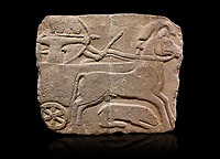 Hittite monumental relief sculpted orthostat stone panel. Limestone, Karkamıs, (Kargamıs), Carchemish (Karkemish), 900-700 B.C. Hunting carriage.  Anatolian Civilisations Museum, Ankara, Turkey.<br /> Two human figures; one handling the carriage, the other throwing arrows. Both figures are wearing a headdress shaped like a skullcap. The dagger at the waist of the figure throwing arrow draws attention. There is an animal between the legs of the horse having an aigrette over its head. Anatolian Civilizations Museum, Ankara, Turkey