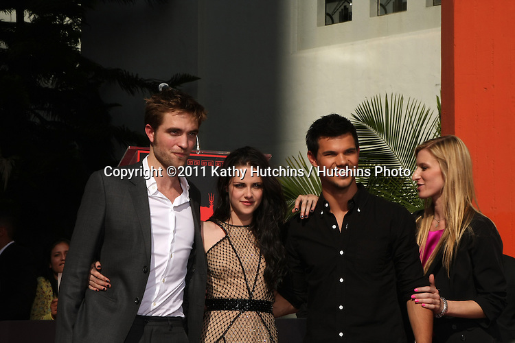 LOS ANGELES - NOV 3:  Robert Pattinson, Kristen Stewart, Taylor Lautner at the Handprint and Footprint Ceremony for the Twilight Saga Actors at Grauman's Chinese Theater on November 3, 2011 in Los Angeles, CA