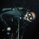 Kenting, Taiwan -- Diver on a night dive.
