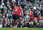 Marcus Rashford of Manchester United celebrates his goal (c) with Anthony Martial and Jesse Lingard of Manchester United during the Barclays Premier League match at The Etihad Stadium. Photo credit should read: Simon Bellis/Sportimage