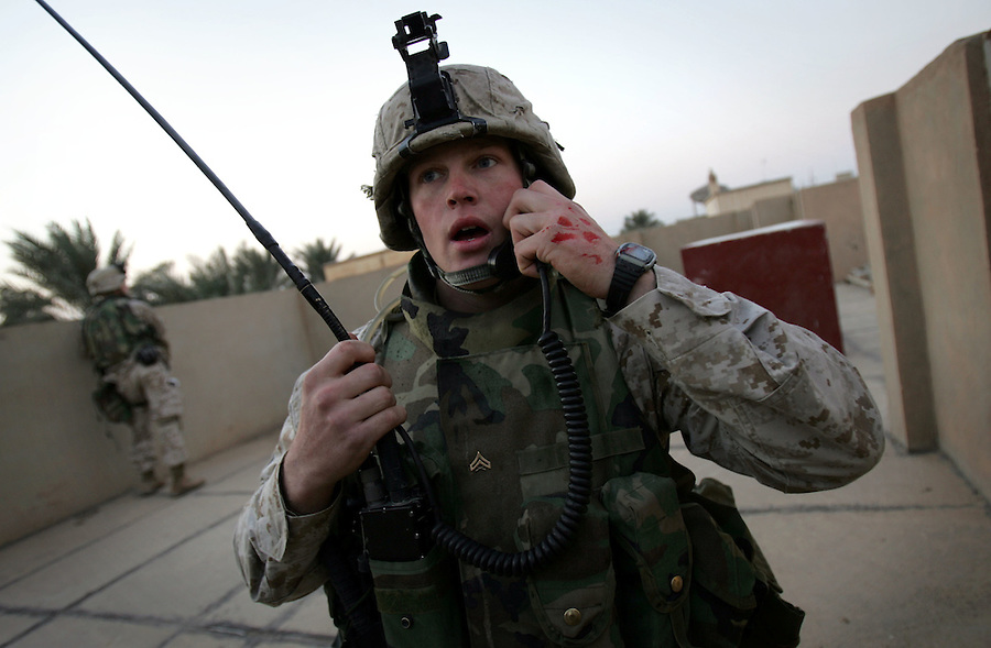 Marines with 2nd Platoon Golf Company 2nd Battalion 5th Marines search for insurgents who attacked their platoon with RPGs and small arms fire - seriously injuring a member of the unit  - as they carried out a daytime patrol on January 11, 2005 in Ramadi, Iraq.