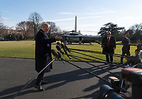United States President Donald J. Trump speaks to the media upon his return to the White House in Washington, DC after a day trip to Camp David on Sunday, January 6, 2019. Photo Credit: Chris Kleponis/CNP/AdMedia
