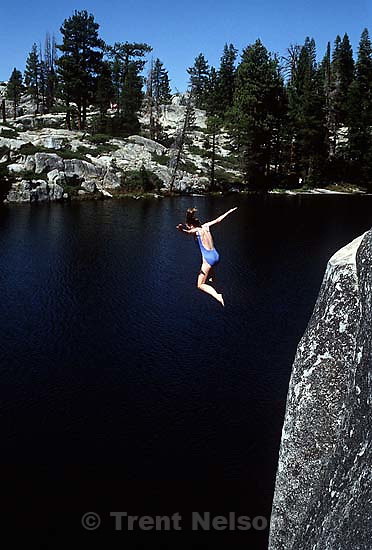Laura Nelson jumping off cliff at Sword Lake<br />
