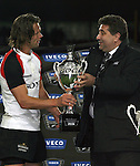 Iveco's Alessandro Cicchetti hands the Trakker Cup to the Canadian Captian after the Iveco rugby union international test match between the All Blacks and Canada at Waikato Stadium, Hamilton, New Zealand on Saturday 16 June 2007. The All Blacks won the match 64 - 13.