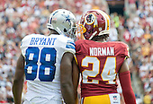 Dallas Cowboys wide receiver Dez Bryant (88) and Washington Redskins cornerback Josh Norman (24) exchange thoughts in early first quarter action during their game at FedEx Field in Landover, Maryland on Sunday, September 18, 2016.<br /> Credit: Ron Sachs / CNP