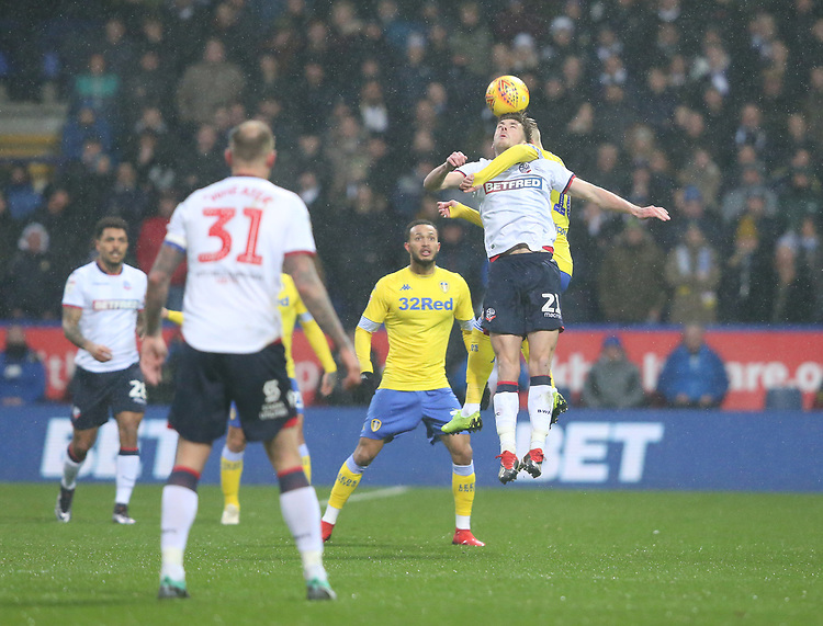 Bolton Wanderers' Joe Williams and Leeds United's Ezgjan Alioski<br /> <br /> Photographer Stephen White/CameraSport<br /> <br /> The EFL Sky Bet Championship - Bolton Wanderers v Leeds United - Saturday 15th December 2018 - University of Bolton Stadium - Bolton<br /> <br /> World Copyright © 2018 CameraSport. All rights reserved. 43 Linden Ave. Countesthorpe. Leicester. England. LE8 5PG - Tel: +44 (0) 116 277 4147 - admin@camerasport.com - www.camerasport.com