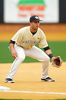 Wake Forest Demon Deacons third baseman Carlos Lopez #3 on defense against the Florida State Seminoles at Wake Forest Baseball Park on March 25, 2012 in Winston-Salem, North Carolina.  The Demon Deacons defeated the Seminoles 7-5.  (Brian Westerholt/Four Seam Images)