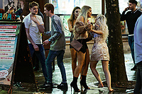 Pictured: A young woman tries to get past her friend. Sunday 31 December 2017 and 01 January 2018<br /> Re: New Year revellers in Wind Street, Swansea, Wales, UK
