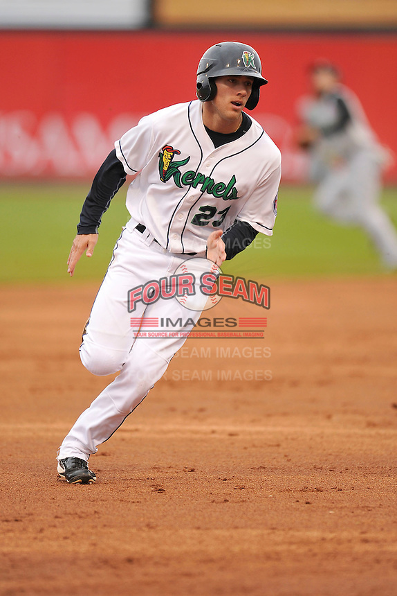 Zack Larson #23 of the Cedar Rapids Kernels runs toward third base against the Kane County Cougars at Perfect Game Field on May 1, 2014 in Cedar Rapids, Iowa. The Kernels won 5-2.   (Dennis Hubbard/Four Seam Images)