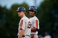 Aberdeen Ironbirds Clay Fisher (19) and Jean Carmona (24) during a NY-Penn League game against the Staten Island Yankees on August 22, 2019 at Richmond County Bank Ballpark in Staten Island, New York.  Aberdeen defeated Staten Island 4-1 in a rain shortened game.  (Mike Janes/Four Seam Images)