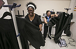 Phyllis Gregg, left, and Lydia Marsette, team up to smooth the wrinkles out of commencement vestments early Sunday, June 11, 2017, before the DePaul University College of Science and Health and College of Liberal Arts and Social Sciences commencement ceremony at the Allstate Arena in Rosemont, IL. (DePaul University/Jamie Moncrief)